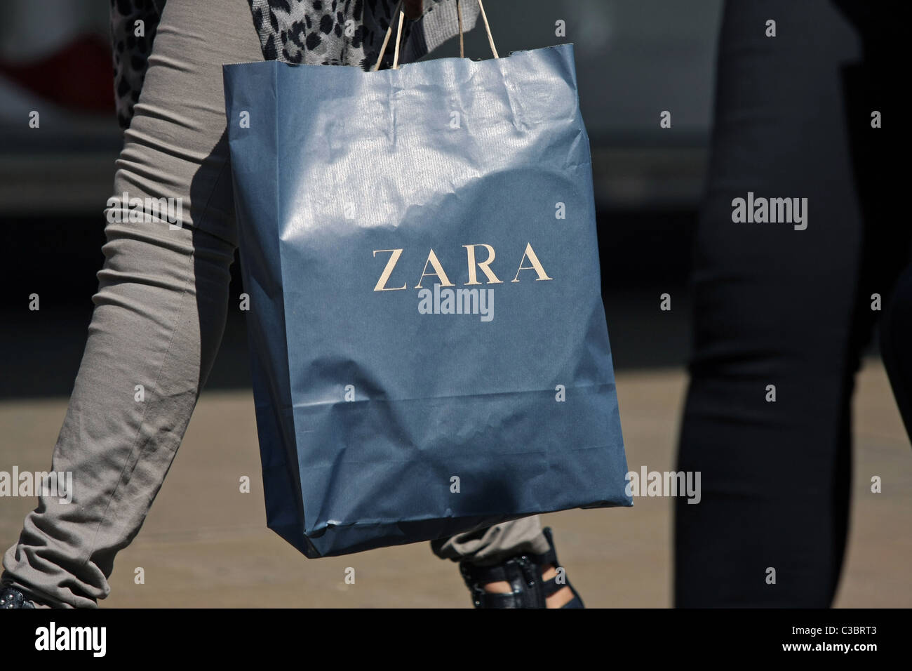 022e6c71 Part of a person carrying a Zara shopping bag in Oxford Street, London,  England