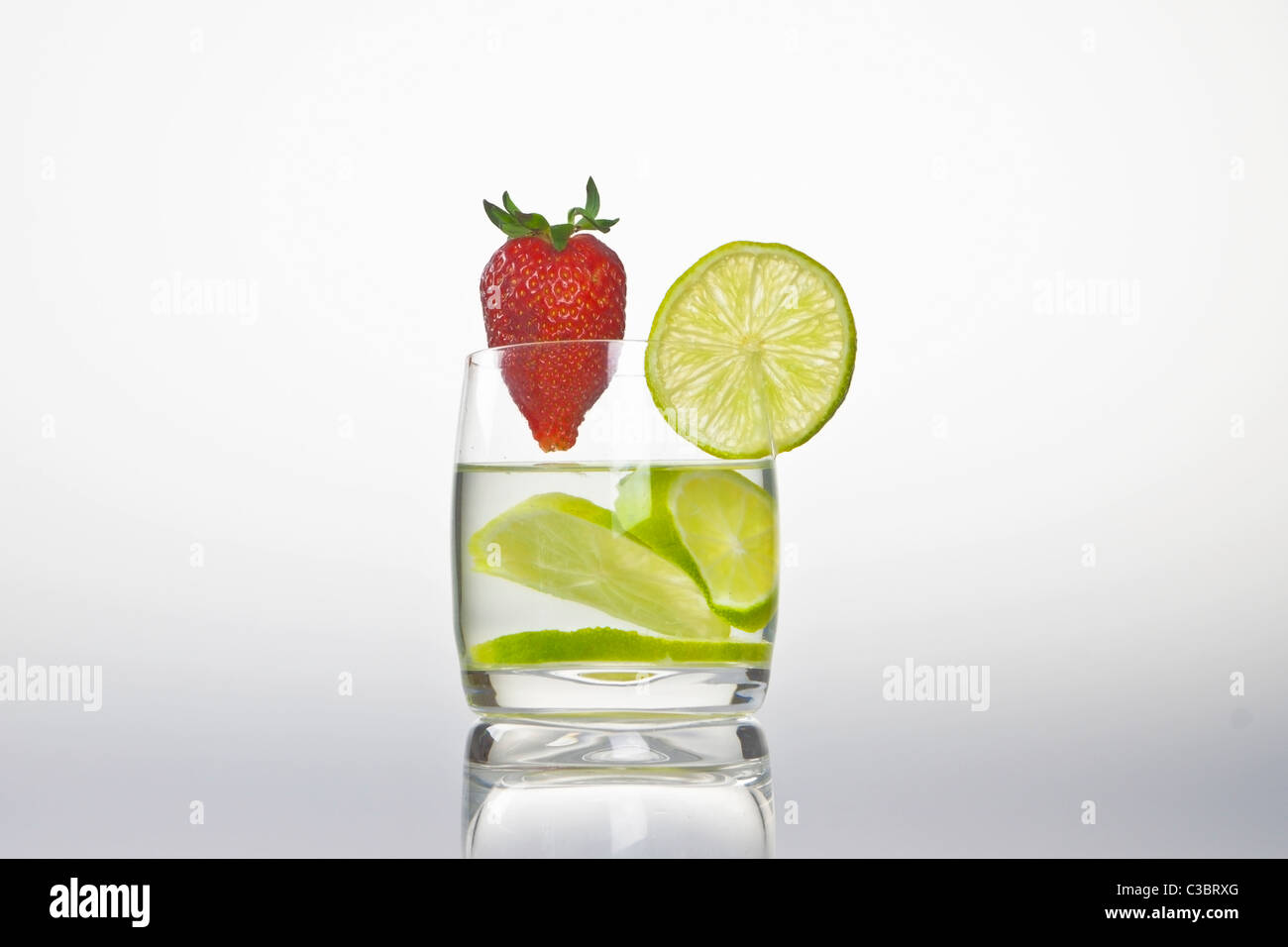 glass with lemon and strawberry - Stock Image