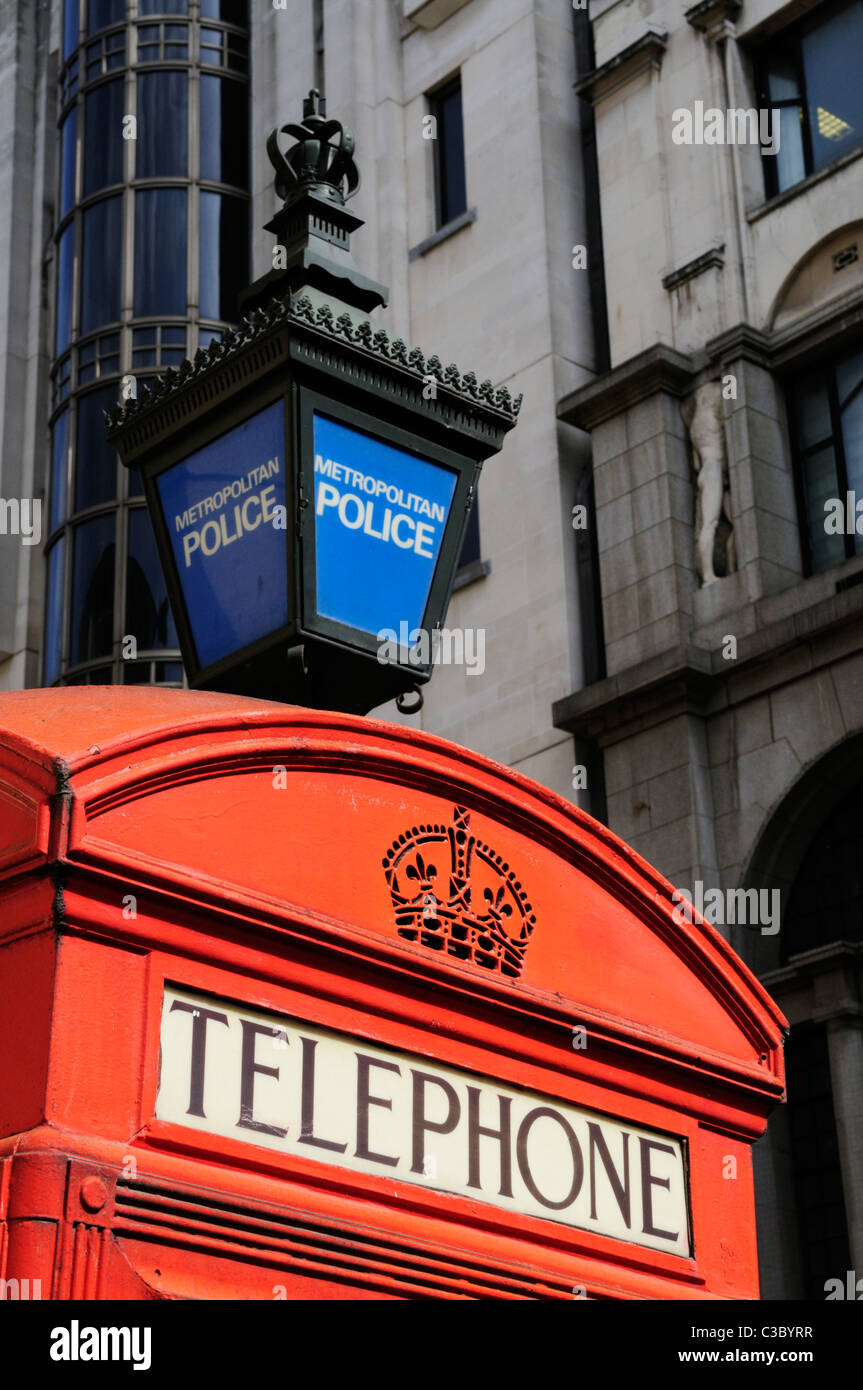 Red Telephone Box and Blue Metropolitan Police Lamp, Agar Street, London, England, UK - Stock Image