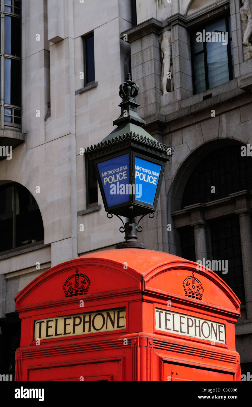 Red Telephone Box and Blue Metropolitan Police Lamp, Agar Sreet, London, England, UK - Stock Image