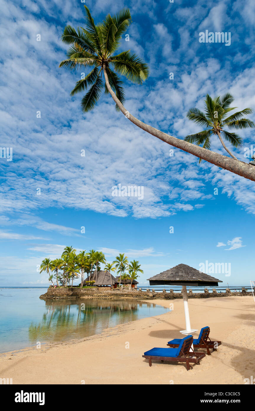 Beach, palm trees and Wicked Walu Restaurant at Warwick Fiji Resort & Spa, Coral Coast, Viti Levu Island, Fiji. - Stock Image