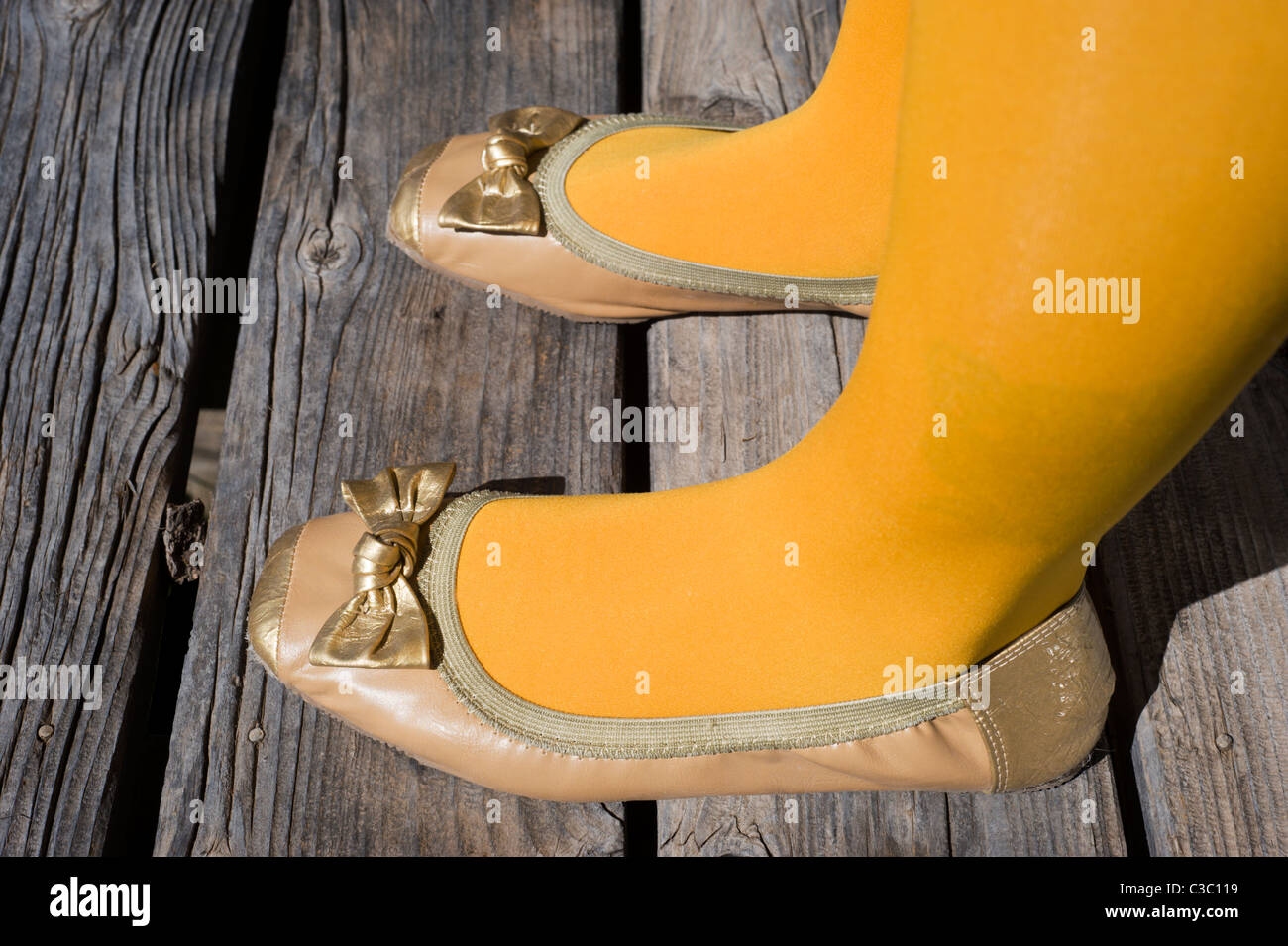 Close-up of a pair of comfy slippers decorated with bows in the Hondo Valley, New Mexico. - Stock Image