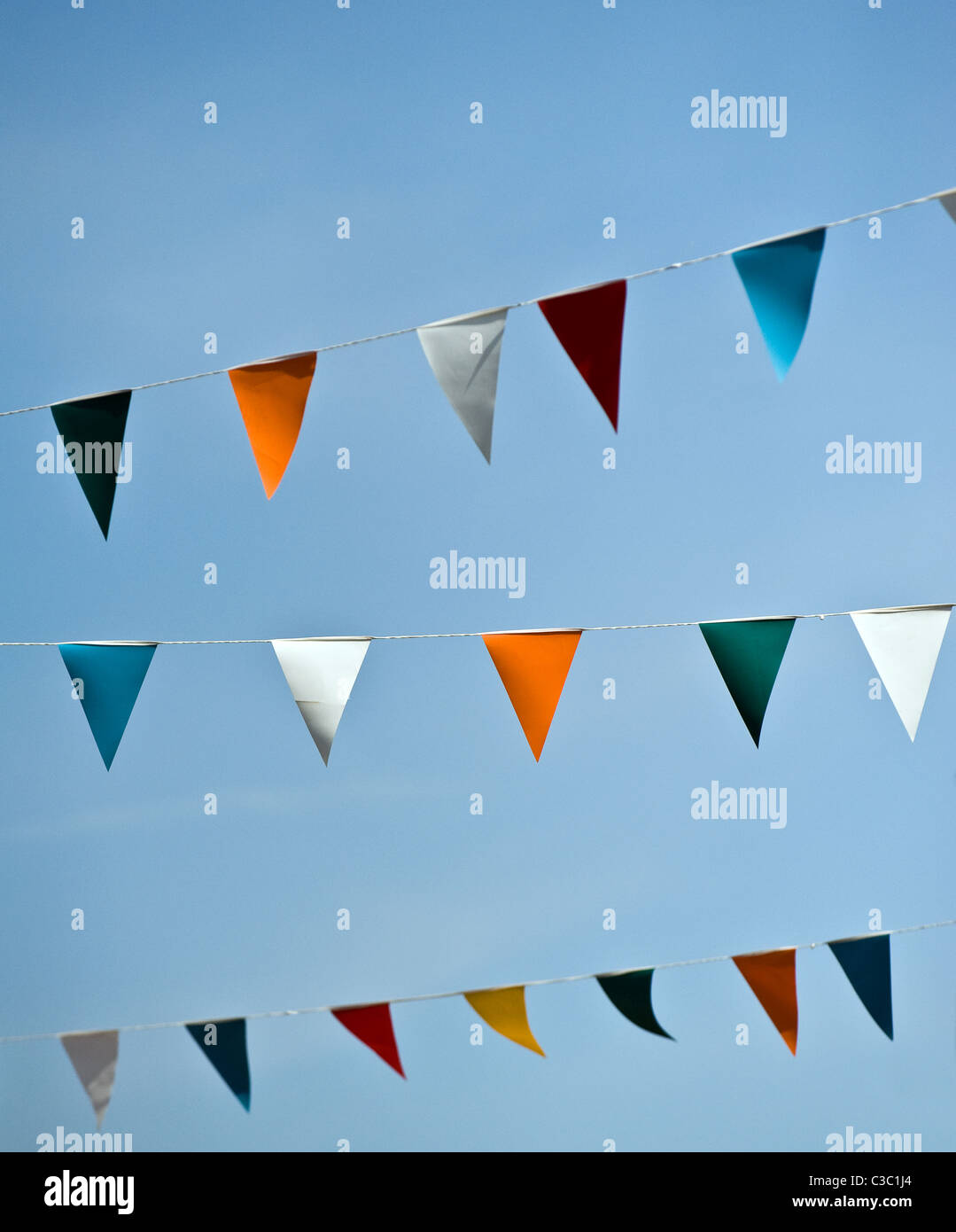 Colourful bunting against a blue sky. - Stock Image
