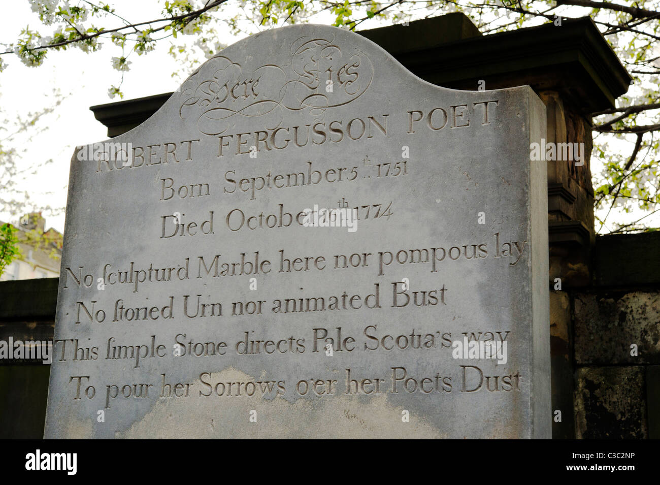 Cemetery of the Kirk of the Canongate, Edinburgh. Tombstone of Robert Fergusson - Stock Image
