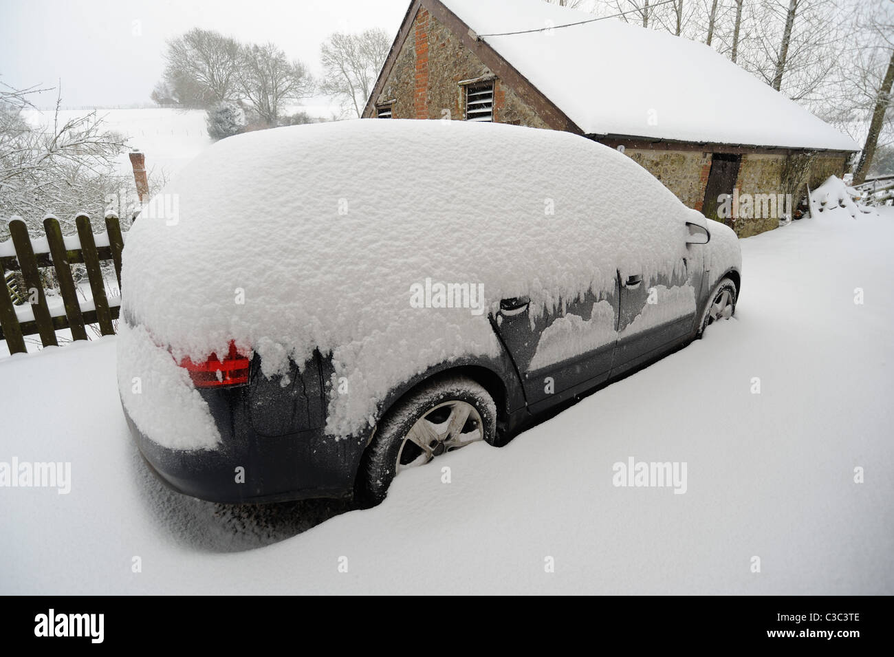 Exceptionally heavy snow cover on a car in East Devon, winter 2010 - Stock Image