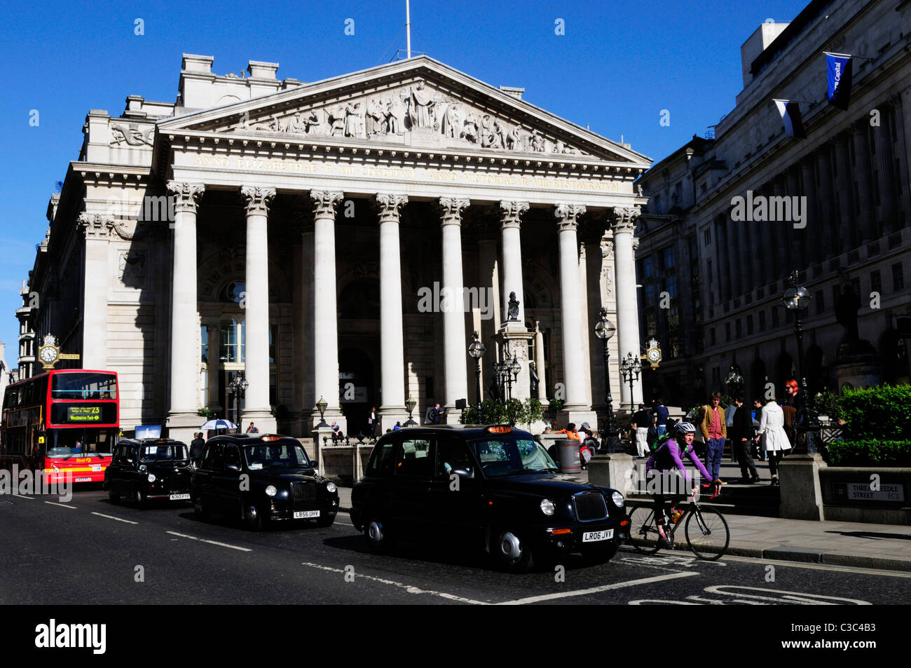 Taxis outside The Royal Exchange, Threadneedle Street, London, England, UK - Stock Image