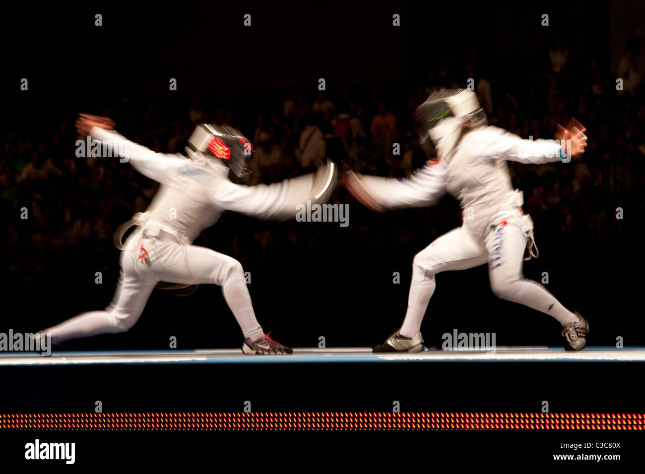 Blurred action of women's fencing competition at the 2008 Olympic Summer Games, Beijing, China Stock Photo