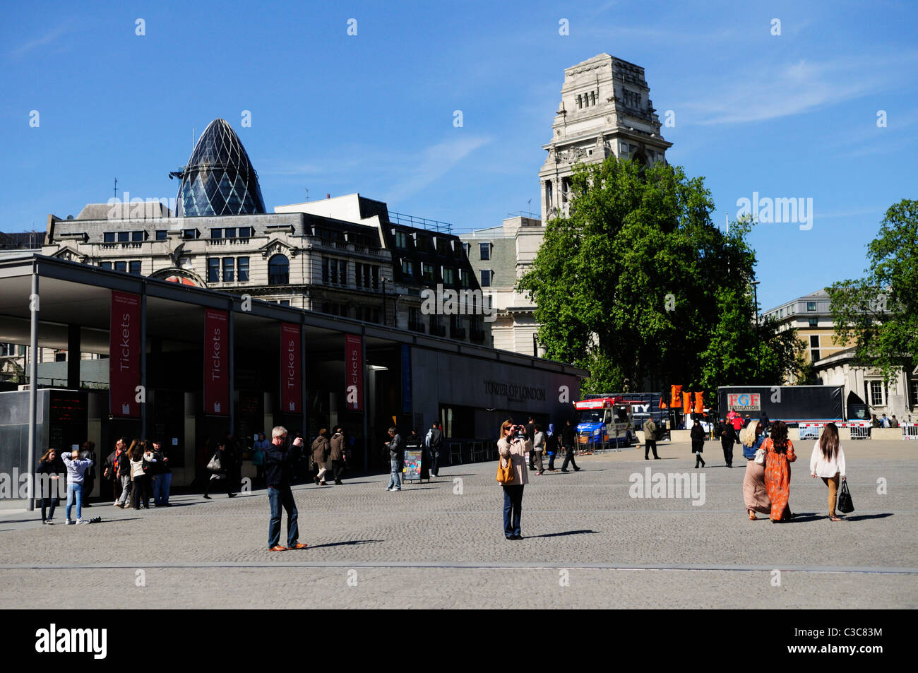 People taking photos outside The Tower of London ticket office, Tower Hill, London, England, UK - Stock Image