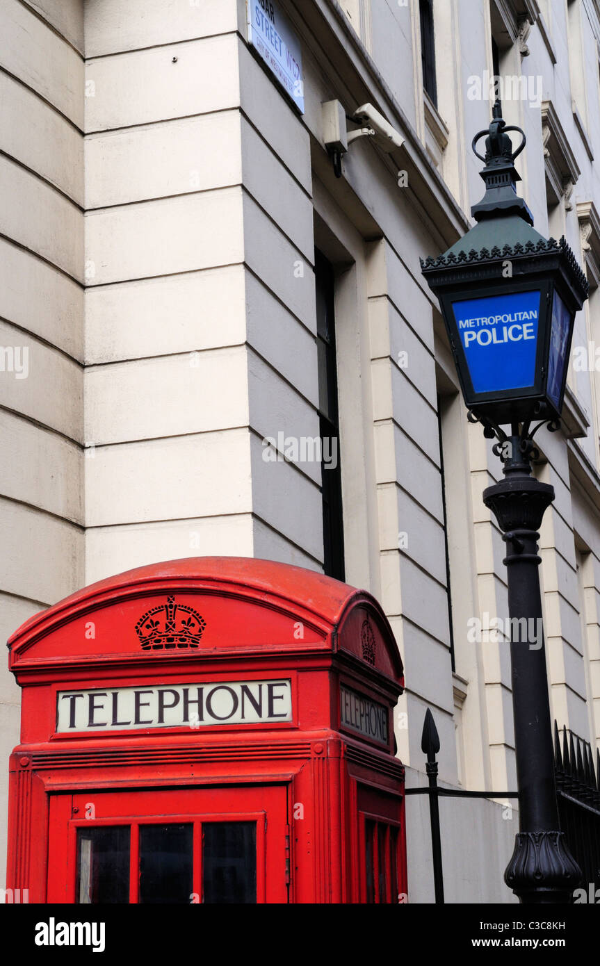 Red Telephone Box and Metropolitan Police Lamp, Agar Street, London, England, UK Stock Photo