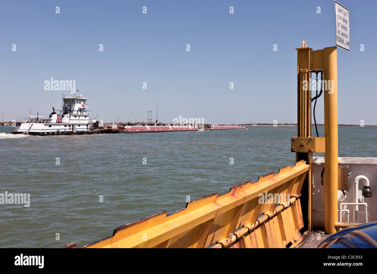 Tugboat pushing fuel barges, Corpus Ship Christi channel, - Stock Image