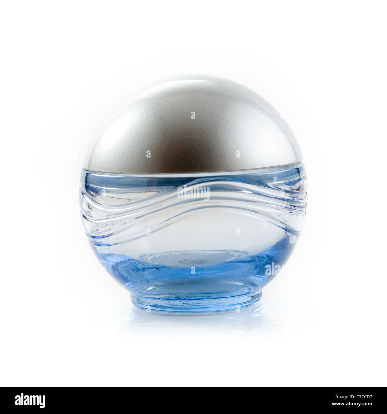 Small decorative perfume bottle, slightly blueish colored - Stock Image