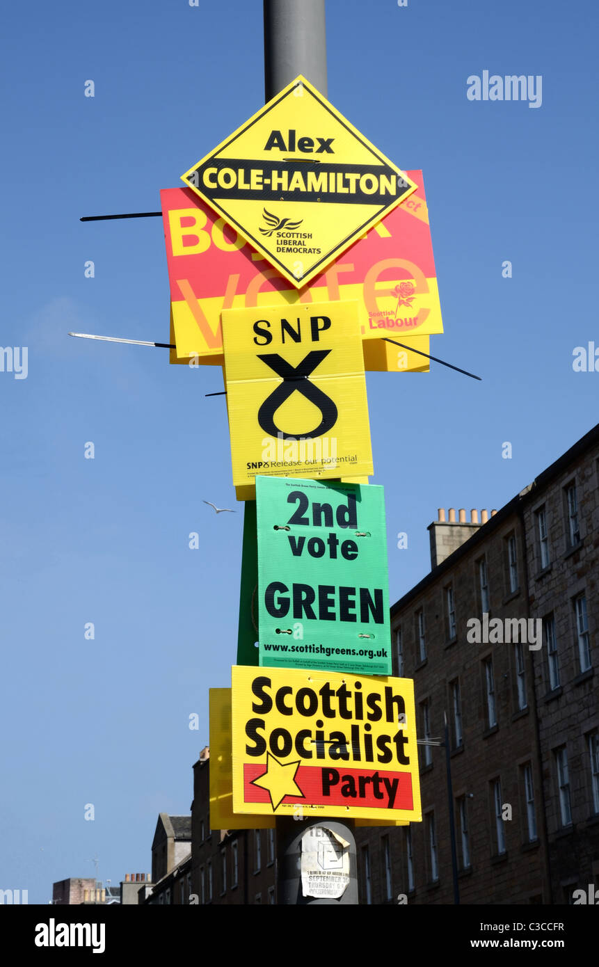 Signs for various political parties standing in the 2011 Scottish Parliamentary elections. - Stock Image