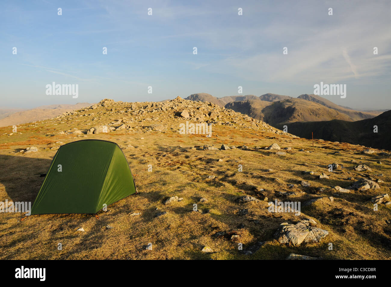 Wild camping on the summit of High Crag in the English Lake District - Stock Image