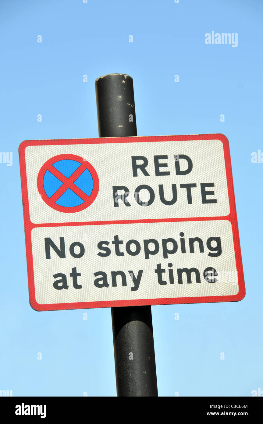 Red Route London parking restrictions sign no stopping at any time park - Stock Image