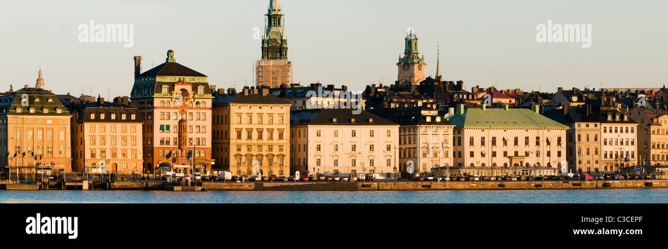 Panoramic view of Gamla Stan in Stockholm with Tyska Kyrkan and Storkyrkan at sunrise from Sodermalm. - Stock Image