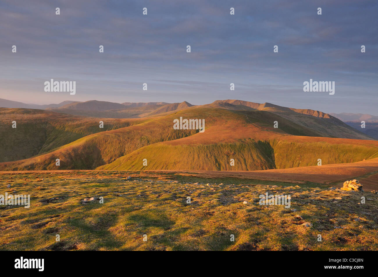 Dawn light on Stybarrow Dodd and Helvellyn, taken from Great Dodd in the English Lake District - Stock Image