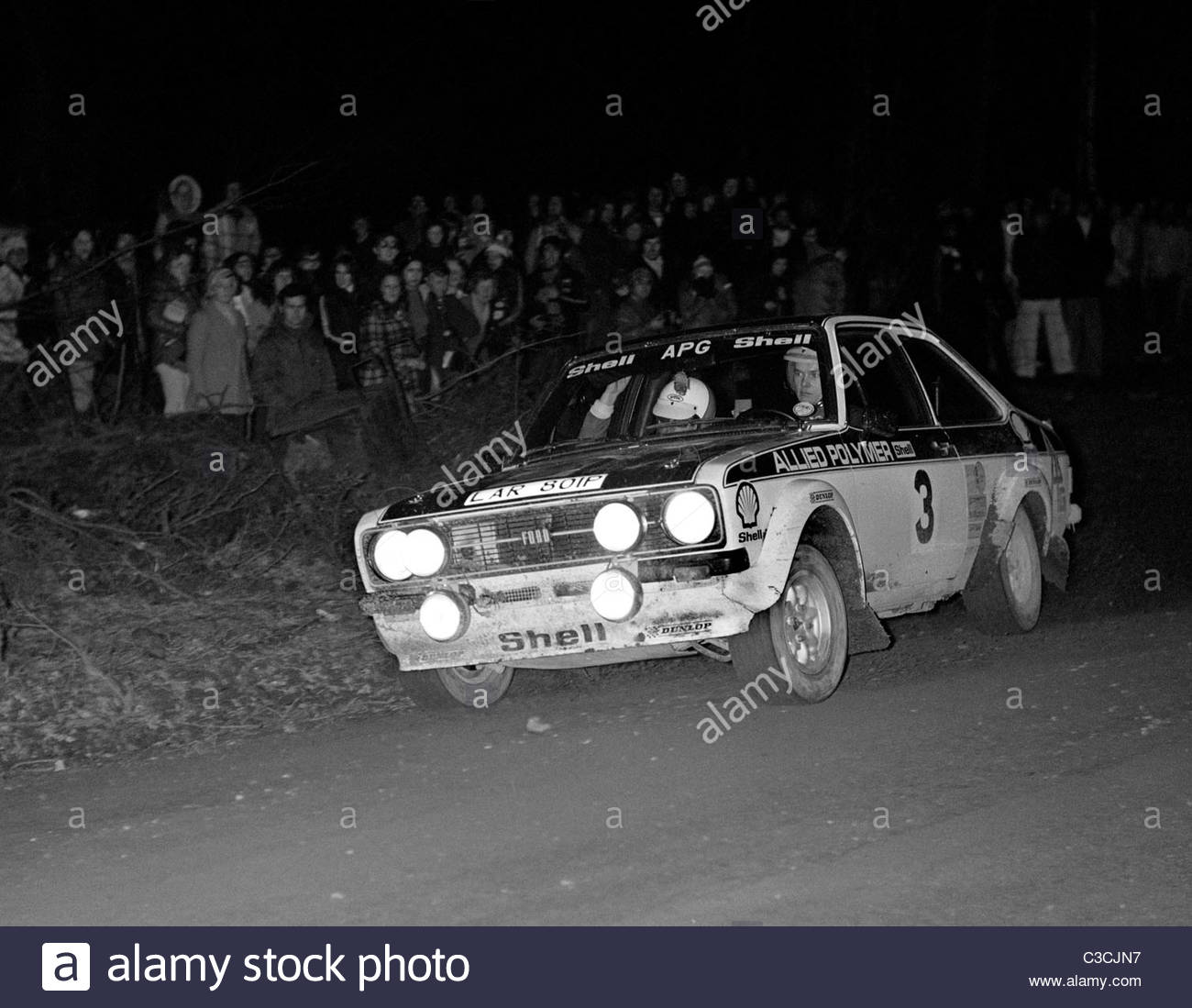 Ford Escort Mk 2 RS1800, driver Ari Vatanen, in a car rally night stage – 1976 - Stock Image