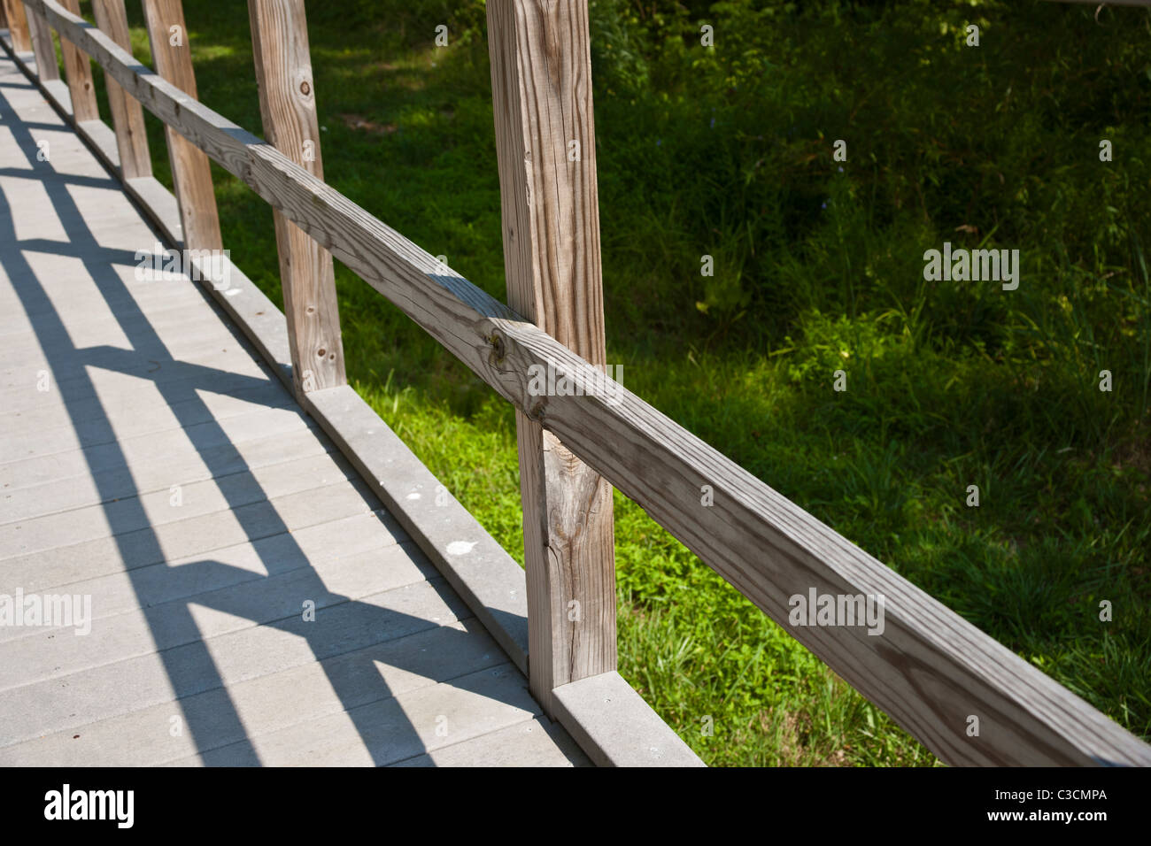 Light and shadow pattern on the wooden boardwalk leading to he Brawner Farm Interpretive Center, Manassas National - Stock Image