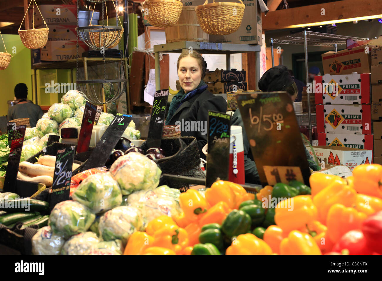Amish woman selling local products at St. Jacobs farmers' market in Ontario Canada 2011 Stock Photo