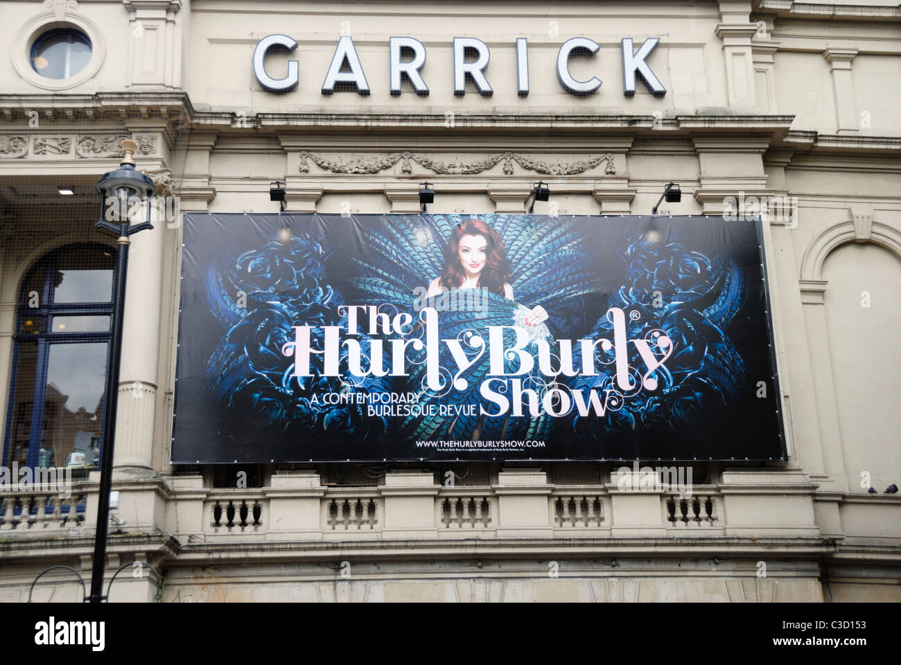 Billboard promoting the Hurly Burly Show, burlesque-inspired revue, London, England - Stock Image