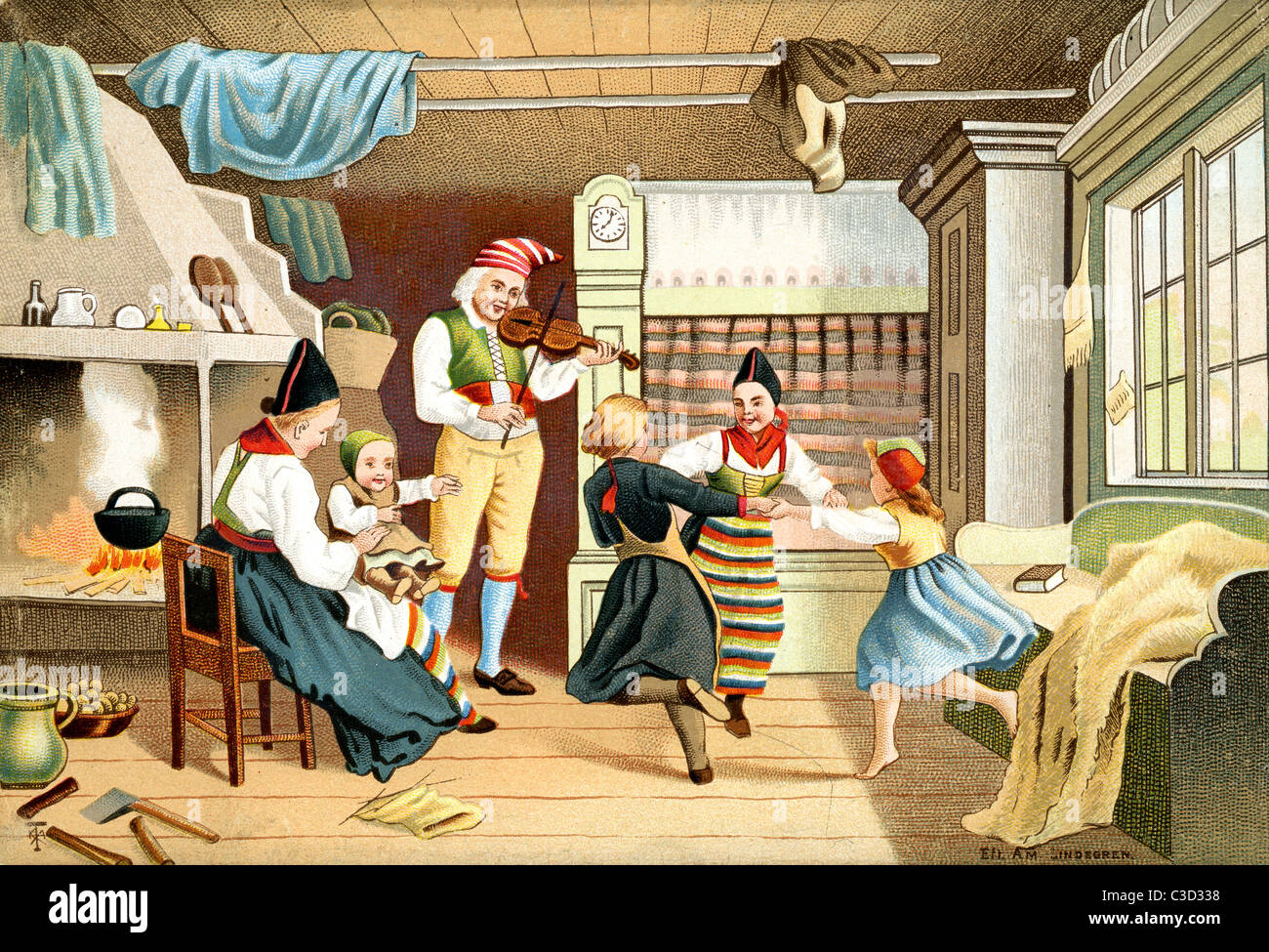 Swedish Family having fun at home with grandfather playing the fiddle and children dancing - Stock Image