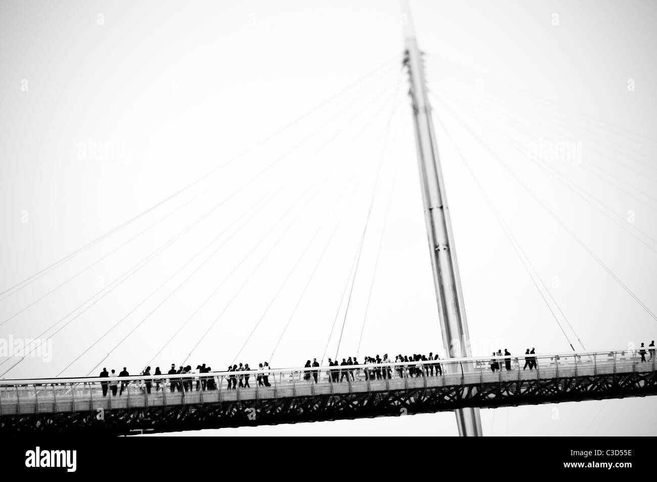 Italy, Pescara. People on cable bridge - Stock Image