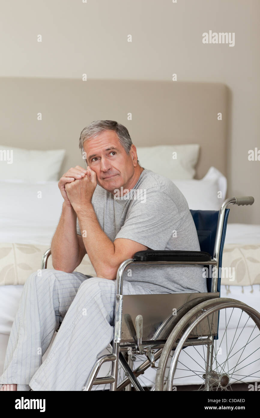 Thoughtful senior man in his wheelchair Stock Photo