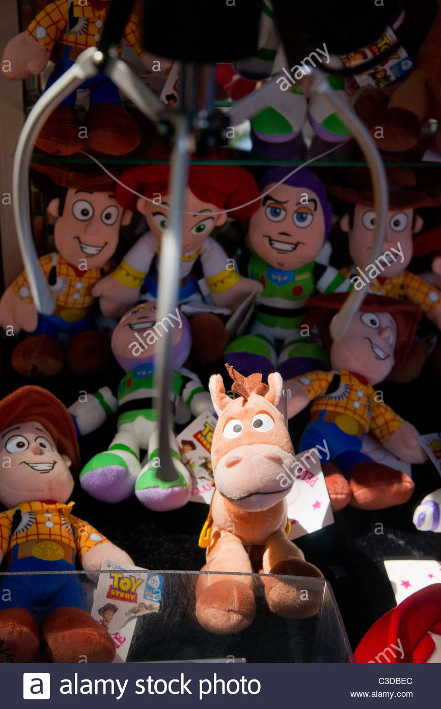 Toy Story Bullseye horse plush waiting to be picked in a fun fair grabber claw game - Stock Image