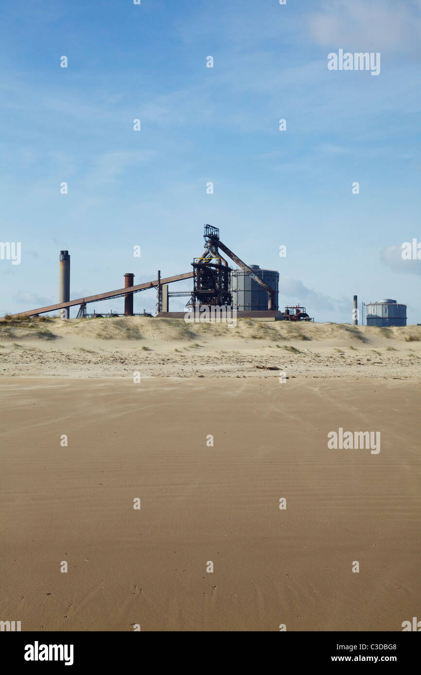 Redcar steelworks and sandy beach - Stock Image