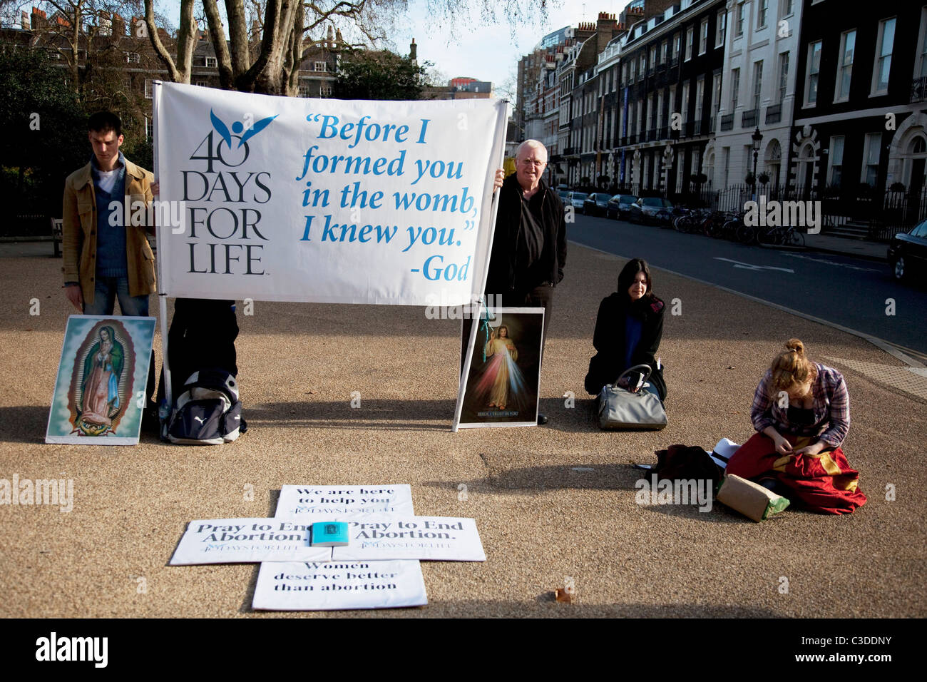 Members of 40 Days For Life protest outside a private abortion clinic. This is an anti abortion or pro life organisation. - Stock Image