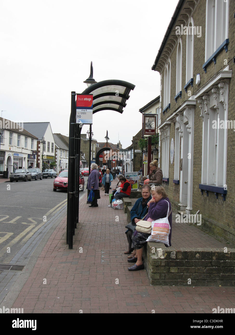 Waiting for a bus, Market Street, Ely - Stock Image