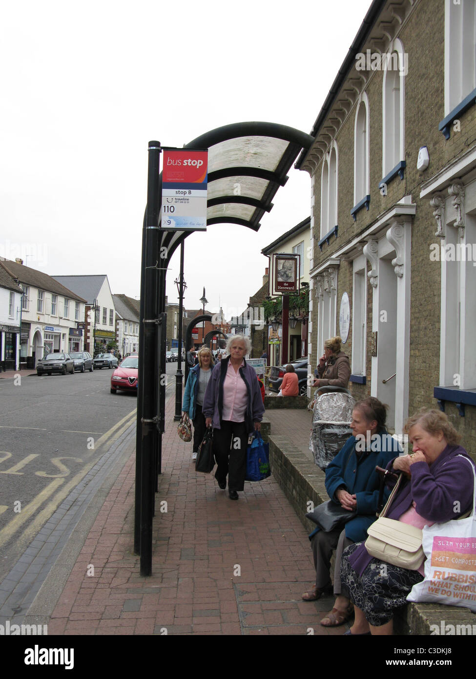 People waiting for bus in Ely - Stock Image