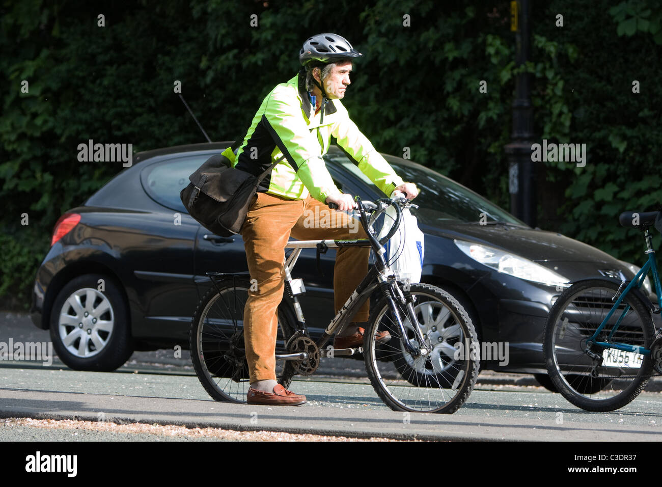Man on bike wearing a Hi Vis vest Stock Photo