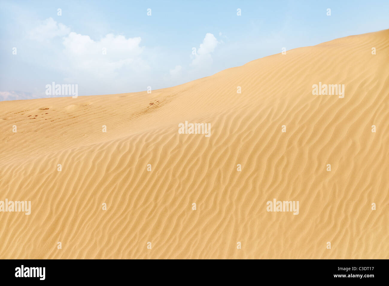 View on the rippled sand dunes in the desert. Natural light and colors Stock Photo