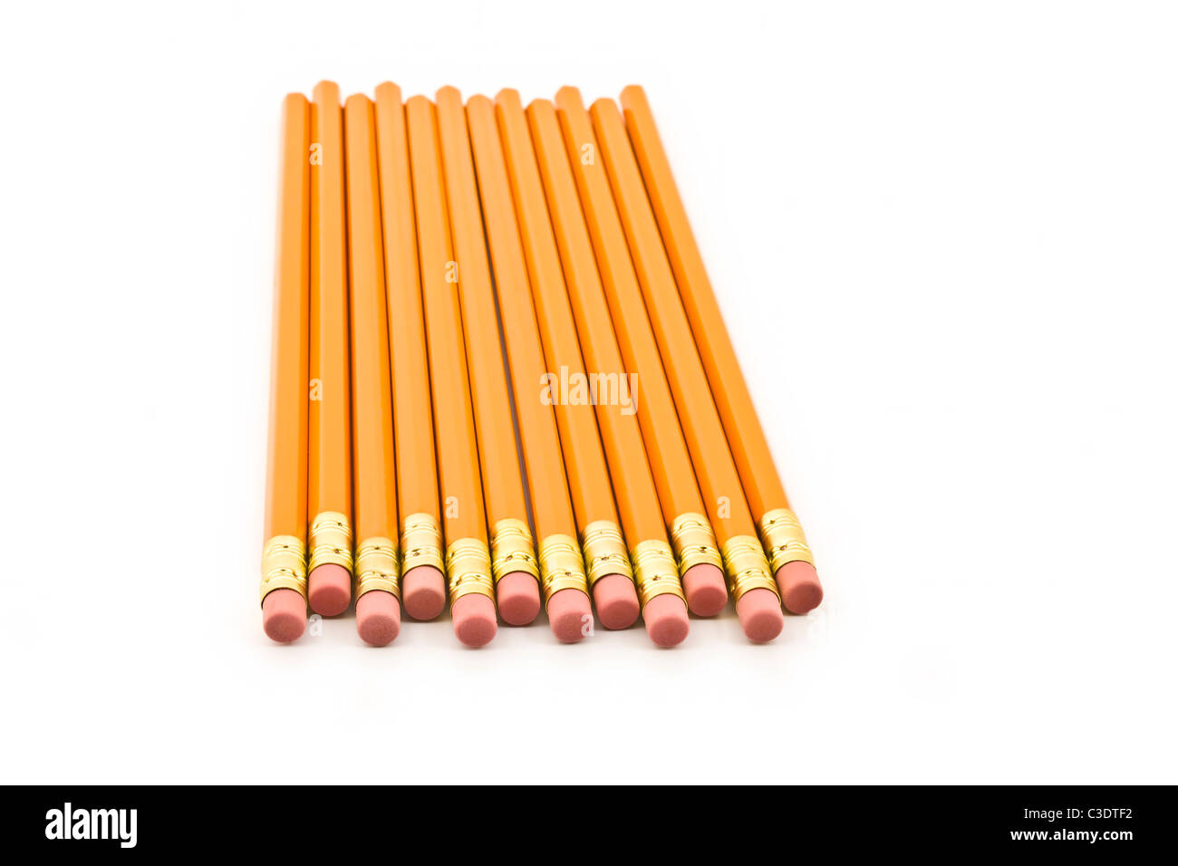Pencils staggered and isolated on a white background - Stock Image