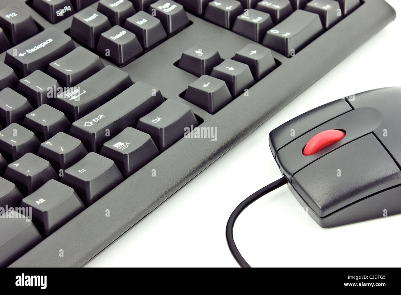 Close up of a black mouse with a red whel and a keyboard isolated on white Stock Photo