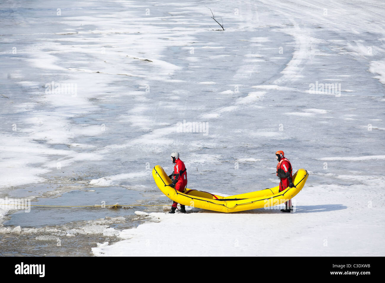 Water rescue workers, wearing cold water survival gear on a training exercise, Assiniboine River, Winnipeg, Manitoba, - Stock Image