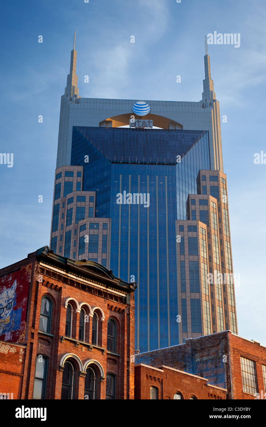 The AT&T building towers over the historic buildings and honky-tonks along lower Broadway in Nashville Tennessee - Stock Image