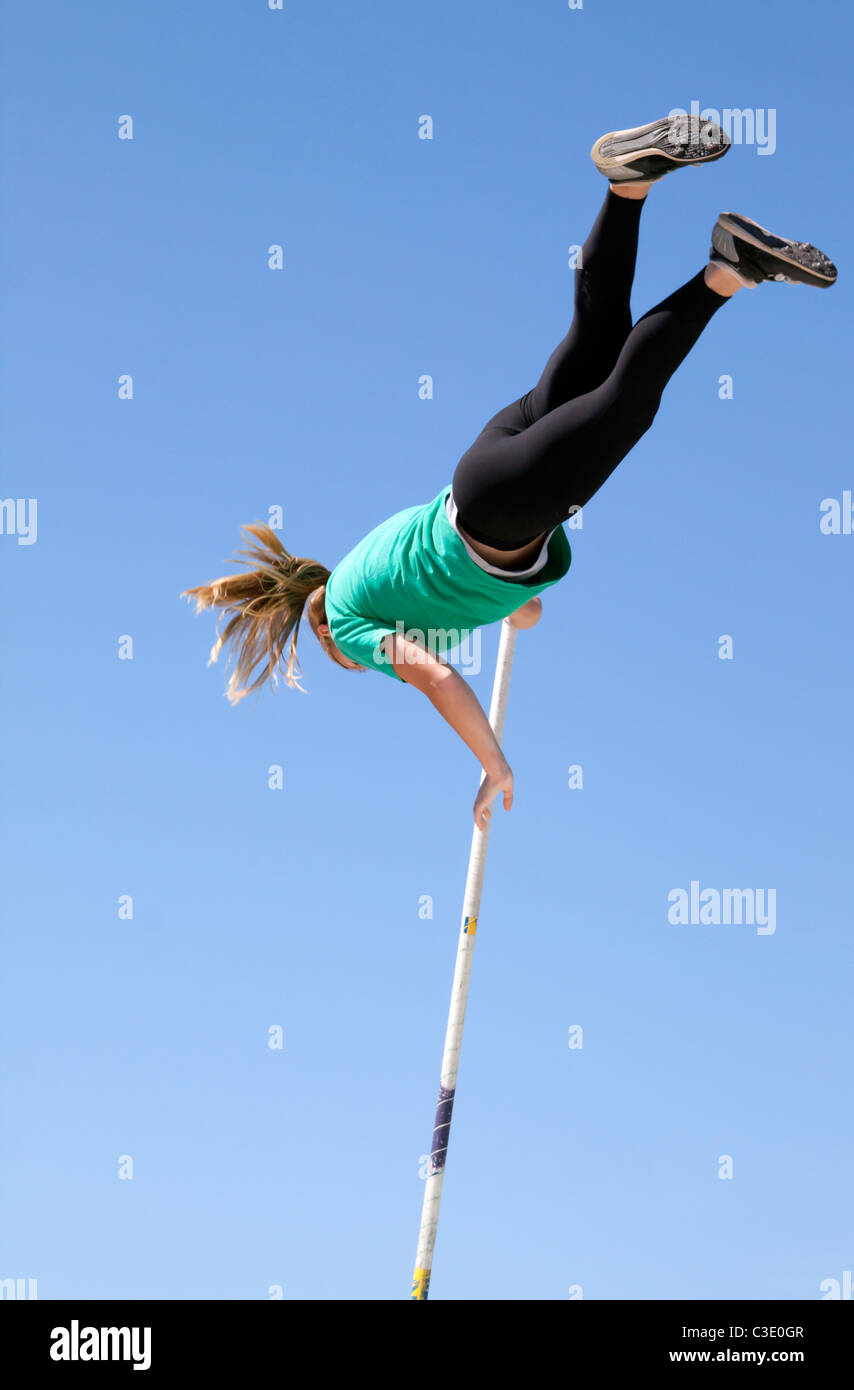 Female pole vaulter practice technique without the bar - Stock Image