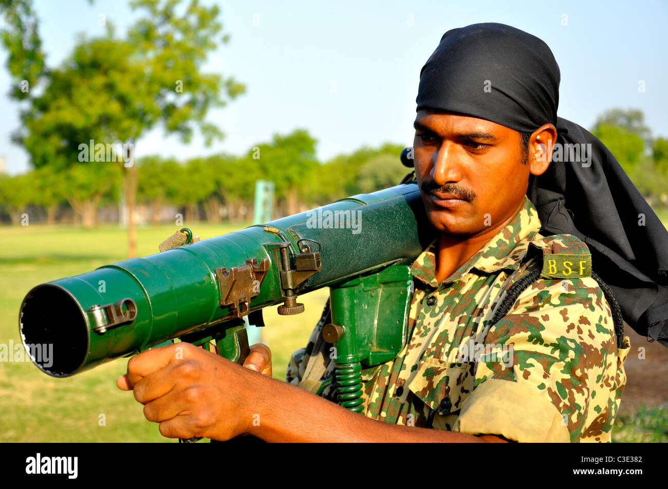 A border security personnel guarding border with rocket launcher - Stock Image