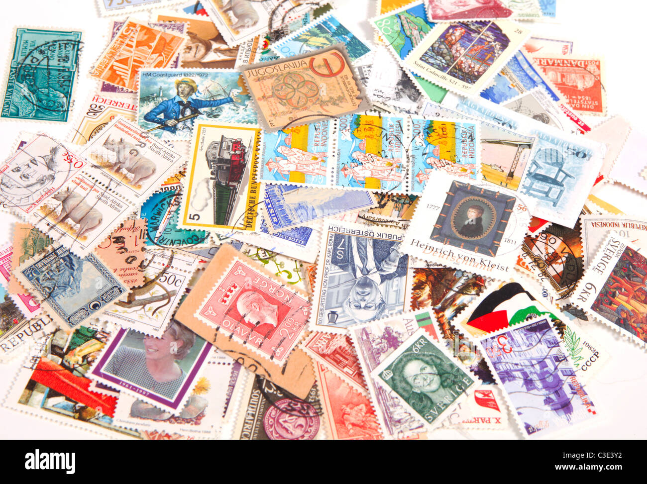 Collection of international postage stamps on a bunch - Stock Image