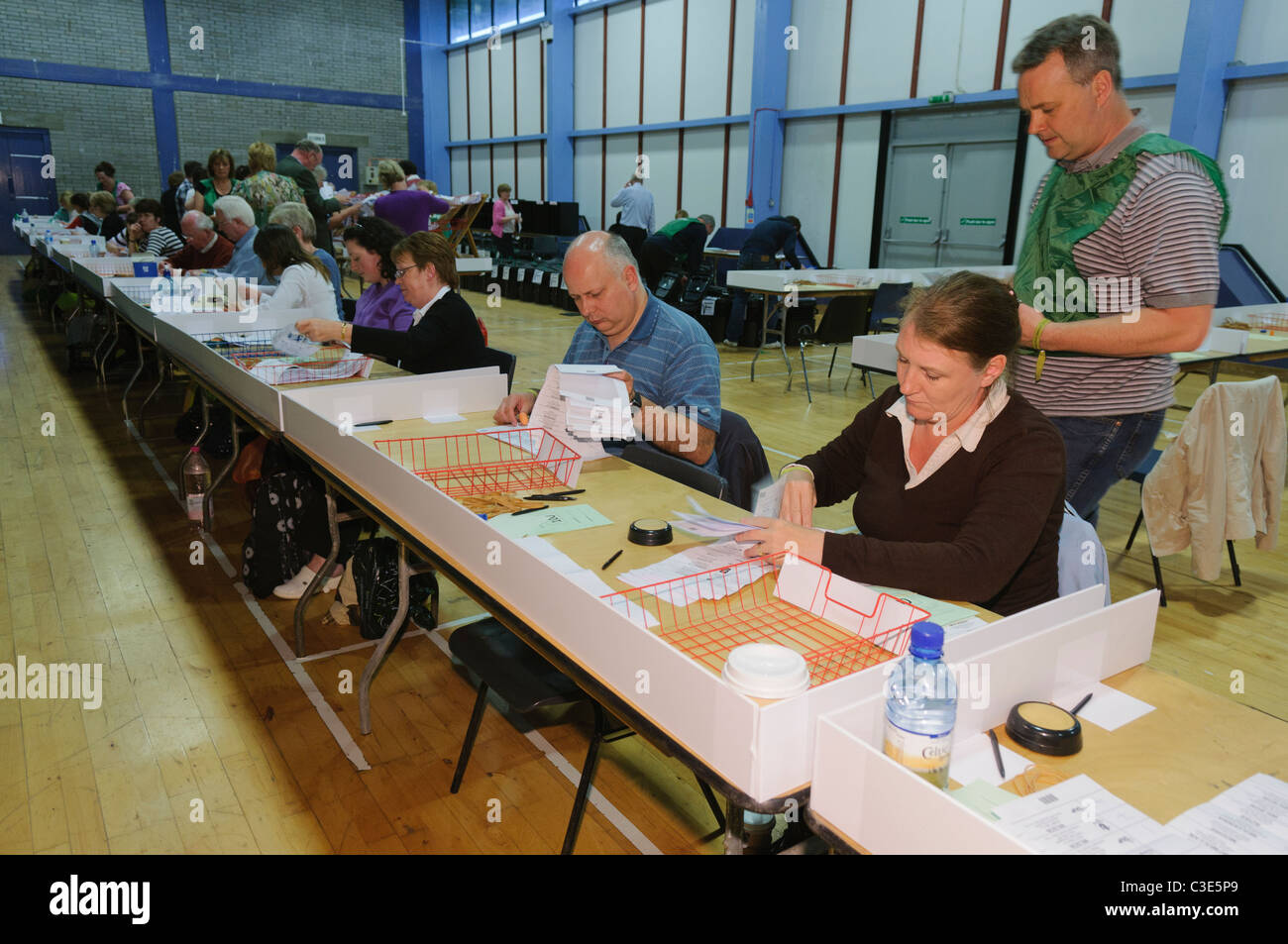 Counting votes at an election count centre - Stock Image