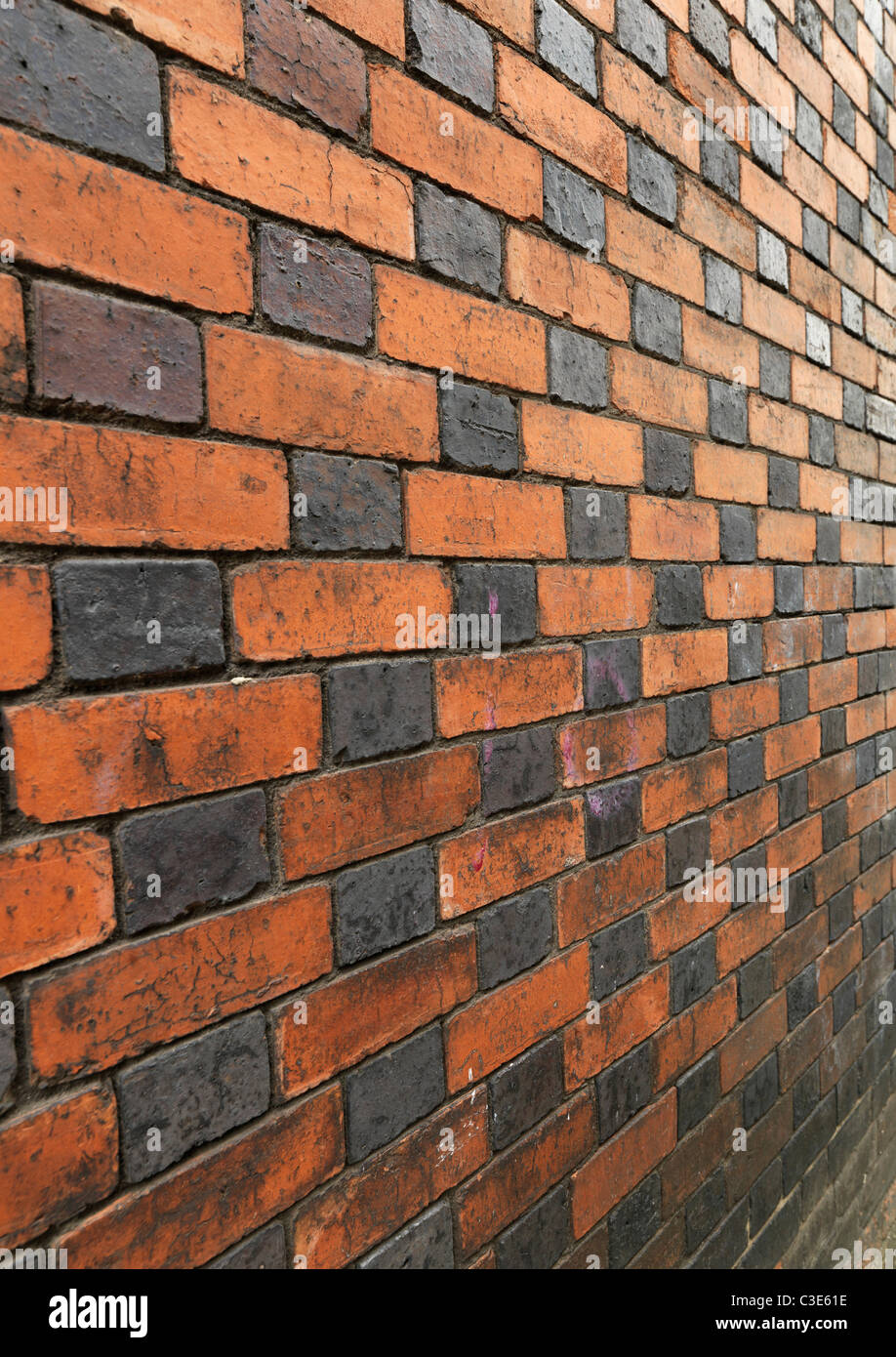 Black and red brick wall - Stock Image