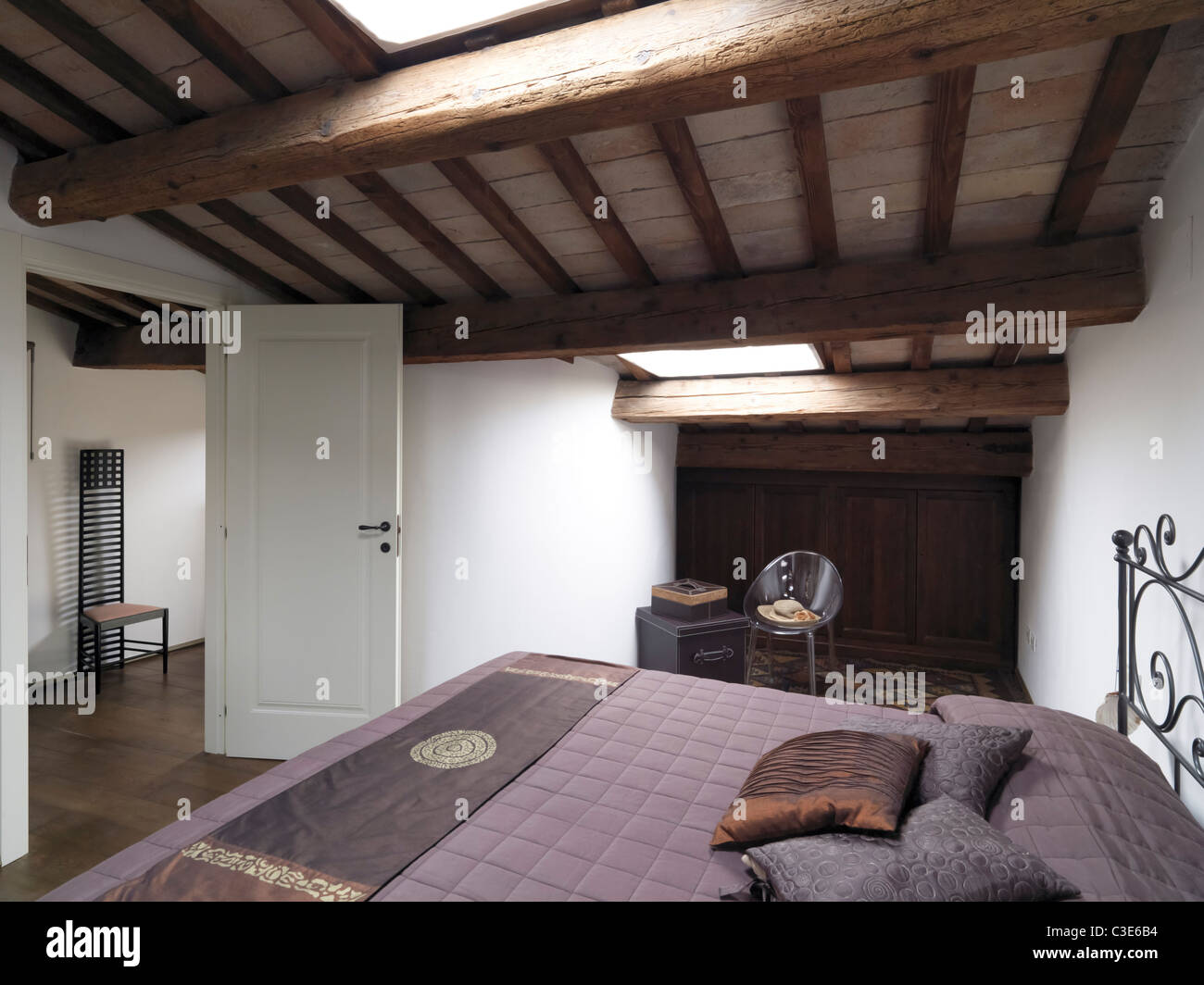classic bedroom in the attic - Stock Image