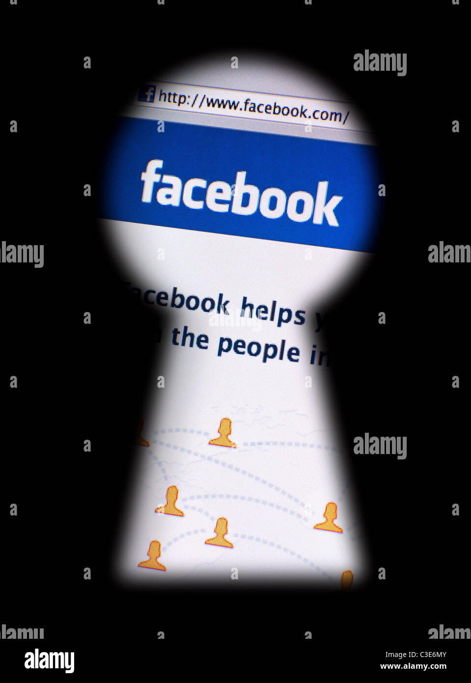 Muenster, Germany - May 7, 2011: facebook.com website seen through a blurred keyhole. Photography concept of data - Stock Image