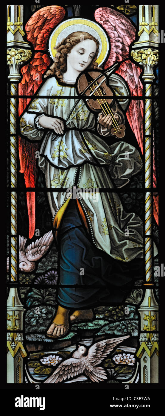 Stained glass window depicting an angel playing a rebec, Booton, Norfolk, England - Stock Image