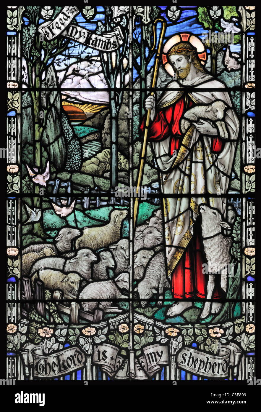 Stained glass depiction of Christ the good shepherd, St Lawrence church, Harpley, Norfolk, England - Stock Image