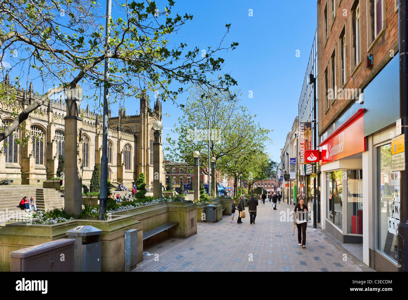 Shops along Kirkgate/Westgate near the Cathedral in the city centre, Wakefield, West Yorkshire, UK - Stock Image