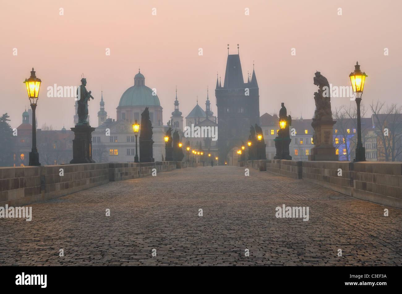 Charles Bridge in Prague during the sunrise, Bohemia, Czech Republic. Stock Photo