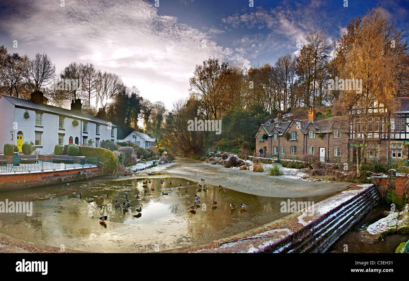 Lymm village centre with frozen dam winter. - Stock Image